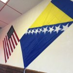 American and Bosnian flags prominently displayed