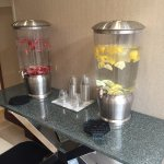 These are containers of cold water with fruit. A very nice feature.