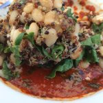 Quinoa, greens and red pepper sauce