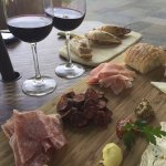 Charcuterie and fromage plate with empanadas in the background. Lovely!