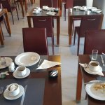 Examples of uncleared tables, mayhem at check in and poor past it best food