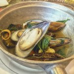 Plump flagrant Mussels in Basil and Cilantro broth $8.95