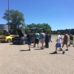 The Lamborghini group learning more about the cars with their two driving sherpas.