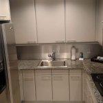 The kitchen in One-Bedroom King Suite - Oceanfront