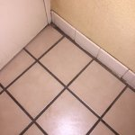 Dirty, dirty tile grout in bathroom