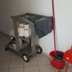 Housekeeping cart with limited domestic cleaners, mop, broom no vacuum cleaner