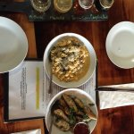 Beer flight, rosemary kale fingerlings, smoked corn beef brisket Mac n cheese, pulled pork slide