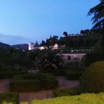 View of the Generalife at night from the garden terrace where meals are served