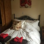 Double room in Guillemot Cottage, small but comfortable.