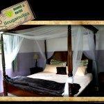 King sized bed in Bougainvillea Cabin
