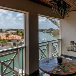 Balcony fully screened-in Breezy Loft apartment at Caribbean Court