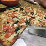 Pizza with tomatoes and spinach