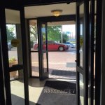 Entry doors open to let air into non-air conditioned lobby