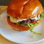 Fire Drill Pepper Jack cheeseburger, salsa verde, aoli, spicy guacamole, slow roasted garli
