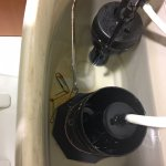 Broken toilet fixed with paperclips