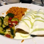 Enchiladas De Espinaca- spinach, Monterey Jack cheese, and mushrooms with sour cream Poblano sau