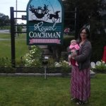 My wife and daughter in front of the sign.