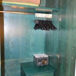 good wardrobe with lots of hangers, safe, and drawers