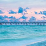 View on the beach at sunset looking out at the Pensacola Beach Pier.