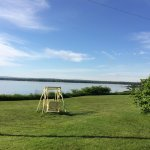 Quaint swing chair on the grounds with the sprawling Bras d'Or lake as a background