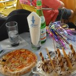 Cheese pizza and banana split, water and a celebration surprise!