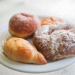 almond croissant, regular croissant, ham & cheese croissant, and boston cream donut.