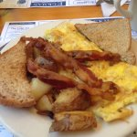 Omelette, potatoes, bacon and toast