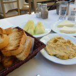 At a Meyhane having meze (appetiser): hummus, cheese and cantaloupe (melon) washed down with Rak