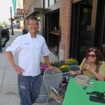 Chef and owner Brian Menges and Cookie chat while she waits for her meal. Menges welcomes dogs.