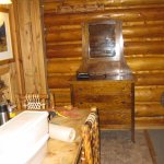 2 beds, dresser, large bathroom, table - rustic touches