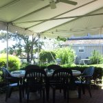 table under the awning-cool and refreshing