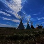 Colorful Tee Pees sit in front of the Custer Battlefield Trading Post