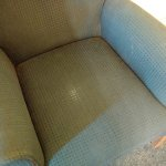 Ran down upholstery of the sofa chair and stains.