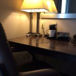 Desk, workstation chair, lamp with AC outlets