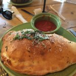 Very quick service and delicious mozzarella sticks, pizza,salad, and calzone!  The red sauce is