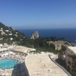 View from room of iconic Fraglioni and the bay and pool