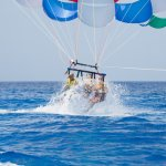 Parasailing--being dipped in the ocean.