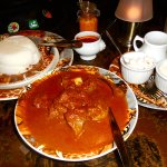 """The white mound, """"ugali"""" is like South African mealy-meal. Great for soaking up spicy goat curry"""