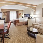 Our King Bed Guest Room with work station is perfect for business