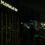 View of the Strip and adjacent big hotel at night