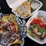 Our Take-out Bounty (clockwise: Chicken Quesadilla, Chicken Tacos Dorados, Fiesta Nachos)