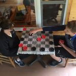 game of checkers on the screen porch