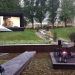 Water feature and garden with huge tv
