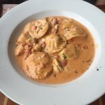 Delicious and perfectly cooked steak topped with shrimp scampi served over lobster mash. Lobster