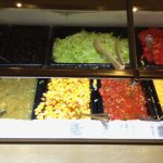 Mexican Station - condiments including salsa, corn, peppers, tomatoes