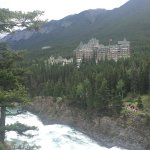 Shot of bow falls in the foreground with the Banff hotel in the background