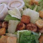 Blackened shrimp on Cesar salad