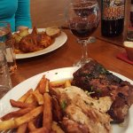 Chicken with garlic potatoes, caramelized ribs with fries.
