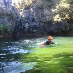 Swimming down the freezing river waters to the next cliff rappel or jump