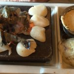 Prawns and scallops on hot lava stone.